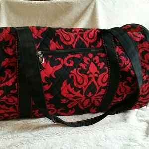 Red and black duffle bag